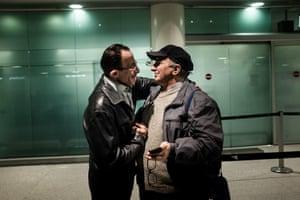 Syrian Mohamed Matok, left, meets Sicilian police officer Angelo Milazz