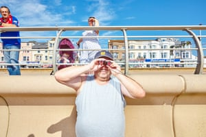 Photojournalism Beach Disaster Photographing quirky British people enjoying the sunshine in Blackpool and Skegness during the 2018 heatwave I noticed the chap with binoculars on my way to Blackpool beach. He looked interesting so I asked if I could take his picture. He hardly noticed me. It wasn't until I started shooting I realised a small crowd was starting to gather. A swimmer was being rescued after getting stranded at sea. I was actually photographing something quite tragic.