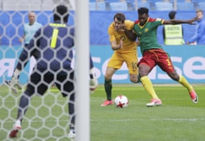 Cameroon's Andre Frank Zambo Anguissa challenges Robbie Kruse.