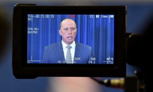 Peter Dutton at a press conference in Brisbane on Friday. Voters support the merging of portfolios but are unsure about giving Dutton control of all security services.