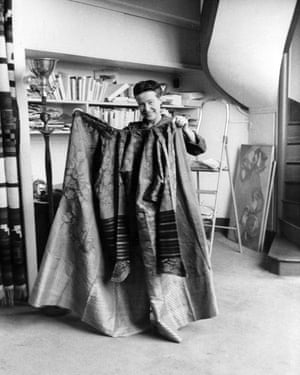 Simone de Beauvoir shows off her traditional silk Chinese theatre robe.