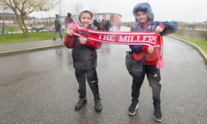Two young Rotherham fans show their support outside the New York Stadium.