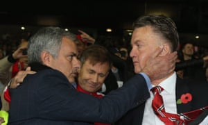 Jose Mourinho embraces Louis van Gaal after Chelsea's match at Manchester United in October 2014
