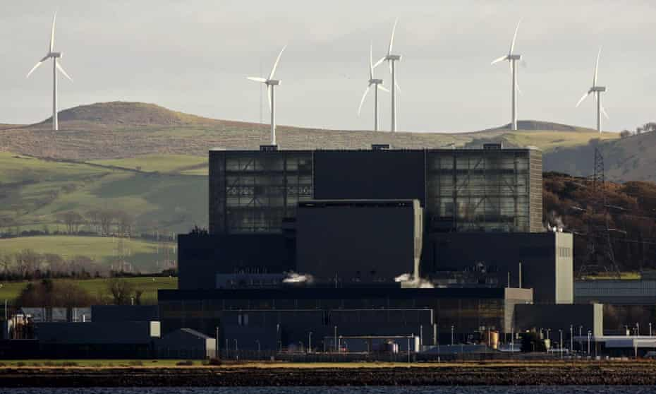 A windfarm on the hills behind Hunterston nuclear power station