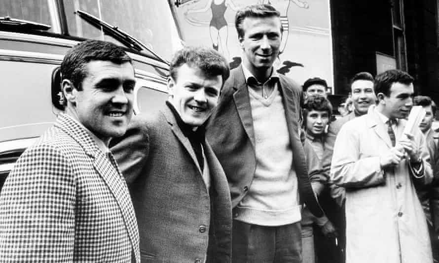 Leeds United football players Bobby Collins, Billy Bremner and Jack Charlton return home to Leeds Central station after their victory over Manchester United in April 1965