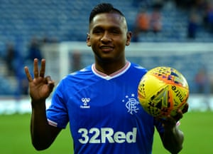 Alfredo Morelos collects the match ball after his hat-trick for Rangers.