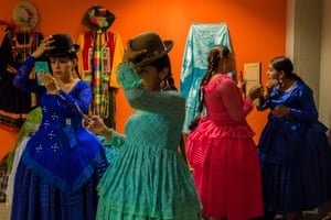 Four cholitas prepare backstage before modelling on the catwalk