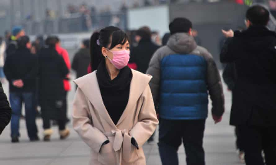 A woman covers her face during heavy pollution in Shanghai, China.