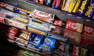 Various chocolate bars on a newsagent's shelves