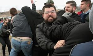 Heimbach fights with demonstrators at Michigan State University, where the speech by Spencer turned chaotic.