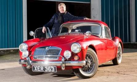 Red devil: Jeremy Rata with his MGA 1960. He bought it five years ago and he now owns seven classic cars.