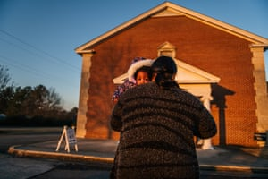 TaRean Howard carries her granddaughter into a polling station at the Garden Lakes Baptist Church on Tuesday in Rome, Georgia.