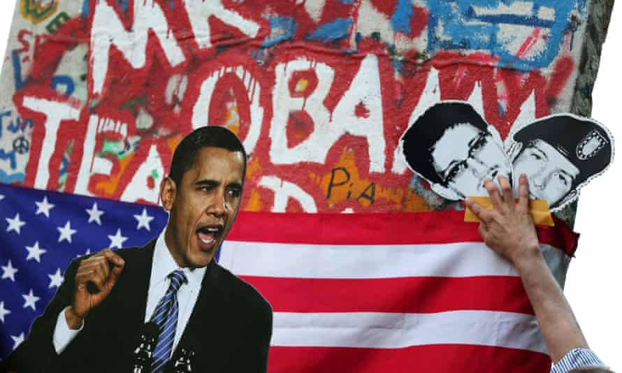 Activists display a photo of US President Barack Obama and pictures of former US spy Edward Snowden (C) and whistleblower Chelsea Manning during a protest in Berlin in 2013.