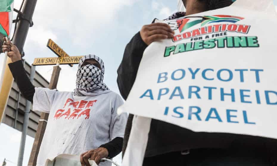 Pro-Palestinian supporters hold placards reading 'Boycott Apartheid Israel' during a protest to condemn the ongoing Israeli air strikes on Gaza, in Durban, South Africa, this week.