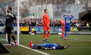 """AFC Wimbledon v Millwall - FA Cup - Fifth Round - Cherry Red Records Stadium<br>AFC Wimbledon's Deji Oshilaja reacts to a missed chance during the FA Cup fifth round match at the Cherry Red Records Stadium, London. PRESS ASSOCIATION Photo. Picture date: Saturday February 16, 2019. See PA story SOCCER Wimbledon. Photo credit should read: John Walton/PA Wire. RESTRICTIONS: EDITORIAL USE ONLY No use with unauthorised audio, video, data, fixture lists, club/league logos or """"live"""" services. Online in-match use limited to 120 images, no video emulation. No use in betting, games or single club/league/player publications."""