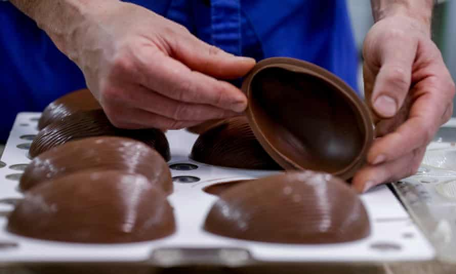 man making easter eggs