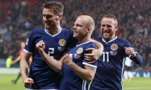 Steven Naismith, centre, and Scotland celebrate a vital win in the Hampden rain.