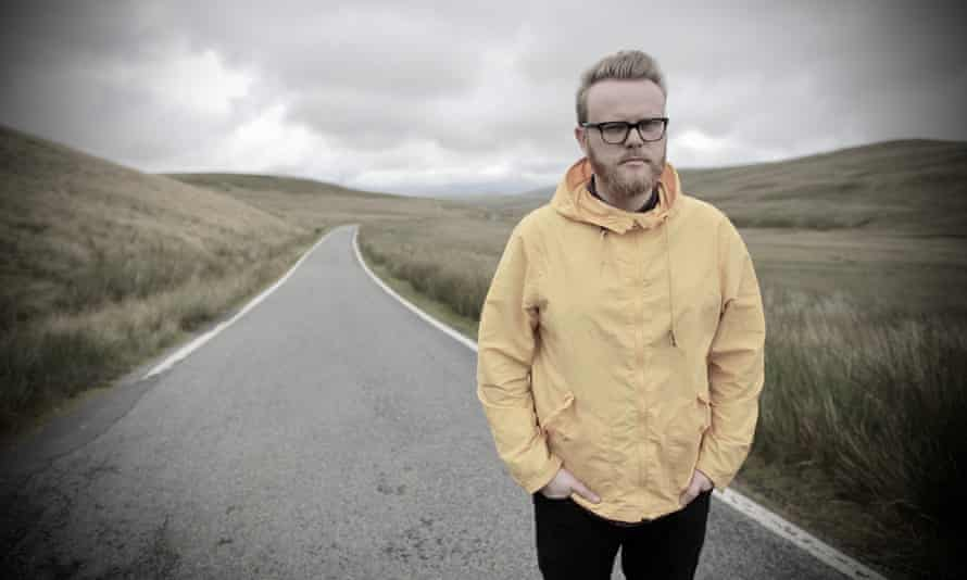 Huw Stephens, with his anorak, in the Welsh countryside.