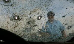 Bullet holes and blood on the windshield from a recent assassination of a police officer in Nuevo Laredo, Tamaulipas.