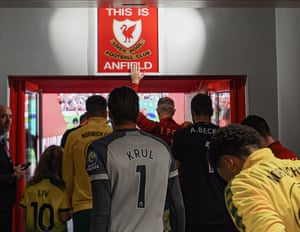 Jordan Henderson leads the Liverpool team out for the opening match of the season against Norwich City at Anfield. Goalkeeper Alisson suffered a calf injury during the match that kept him out for several weeks.