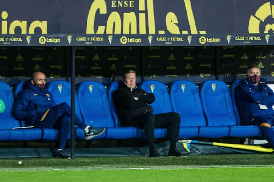 Ronald Koeman watches on from the dugout.