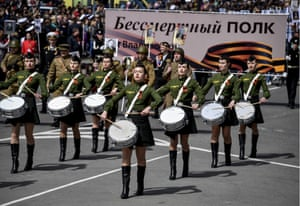 A military band marches in Vladivostok