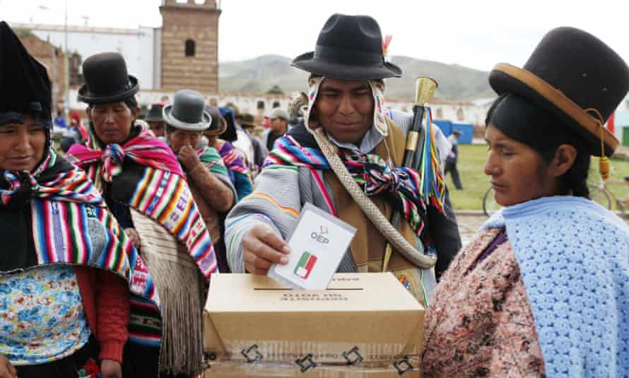 An Aymara Indian casts his ballot at a voting centre during the constitution referendum in Jesus de Machaca, Bolivia.