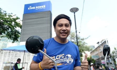 Jiratha Pawadee, 33, gives a thumbs up outside the Bangkok headquarters of King Power, a company owned by Thai magnate Vichai Srivaddhanaprabha who also knowns English Premier League champions Leicester City.