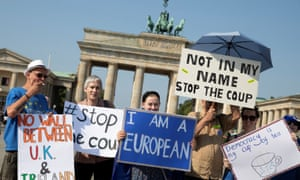 Protesters in front of the Brandenburg Gate in Berlin on Saturday
