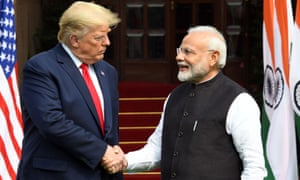 Donald Trump shakes hands with Narendra Modi before their meeting at Hyderabad House in New Delhi