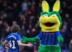 Luke Matheson celebrates with the Rochdale mascot, Desmond the Dragon.