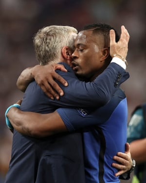 Didier Deschamps embraces Patrice Evra after France's 2-0 victory over Germany in the Euro 2016 semi-final.