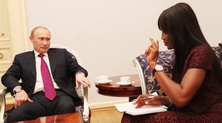 Naomi Campbell with Vladimir Putin at the Tiger Summit in St Petersburg in 2010