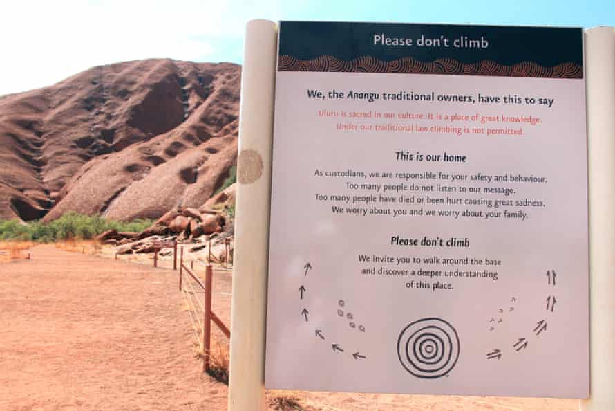 Sign at the base of Uluru asking visitors not to climb