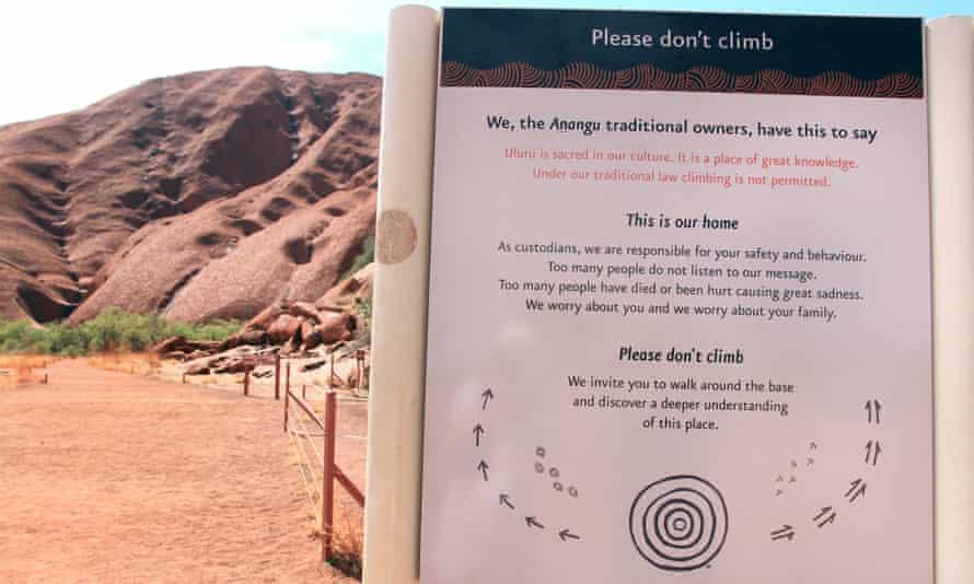 A sign at the base of Uluru in Australia's Northern Territory.