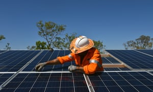 Northern Territory workers install solar panels in Daly River, August 11, 2017.