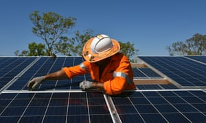 Northern Territory workers install solar panels in Daly River in 2017