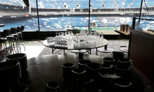 Glassware is set-up for auction inside the Silverdome in an effort to raise funds