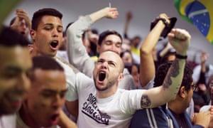Supporters of Bolsonaro react in Sao Paulo.