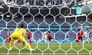 The ball deflects off Denis Zakaria of Switzerland from a shot by Jordi Alba to give Spain the lead.