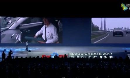 Baidu CEO Robin Li talks to the AI developer conference while in a driverless car.