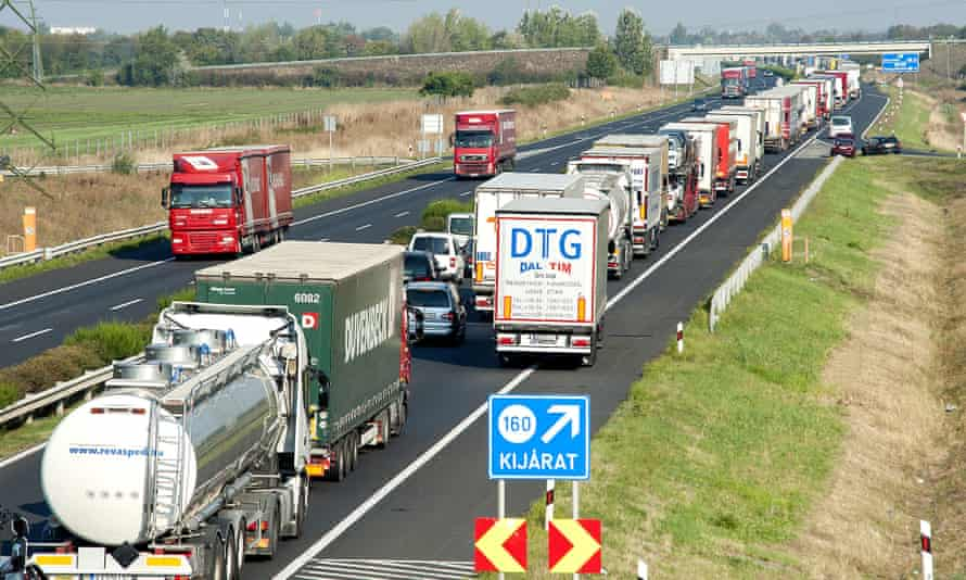 A long queue of vehicles waits on the M1 motorway near the border between Hungary and Austria.