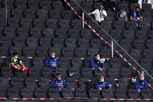 SC Paderborn squad members wearing protective face masks as they watch from the stands.