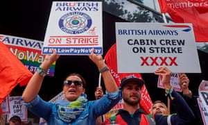 Demonstrators hold placards as they protest in London  over British Airways mixed fleet cabin crew pay