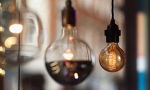 Lightbulbs hang in London, England.