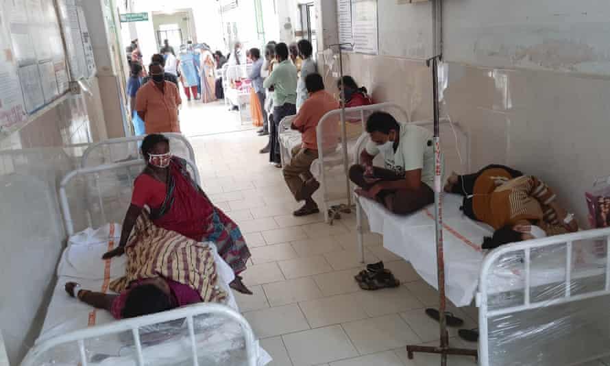 Patients and bystanders in hospital in Eluru, Andhra Pradesh, on Sunday