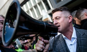 Tommy Robinson greets supporters outside the Old Bailey after his case was adjourned.
