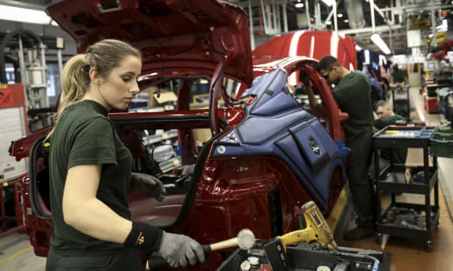 Employees work on a Jaguar production line