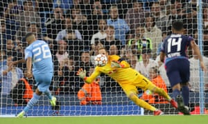 Manchester City's Riyad Mahrez scores their third goal from the penalty spot.