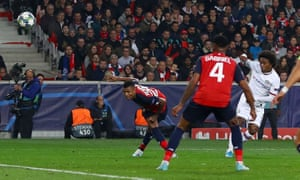 Willian's deflected volley rises and loops over the Lille goalkeeper for Chelsea's second goal.